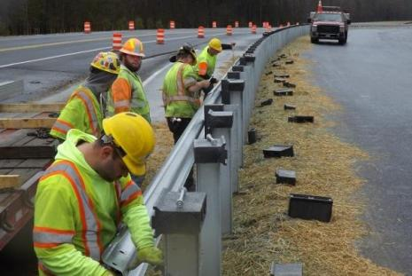 Crews with LS Lee install guardrail between the existing US 113 roadway and the new northbound dual highway alignment.